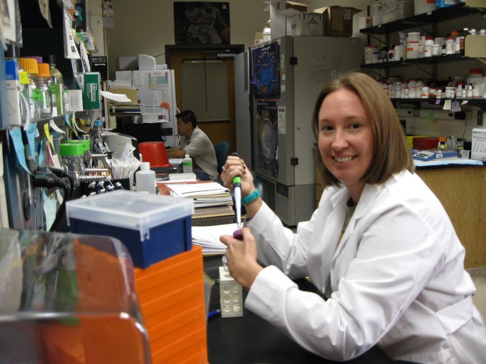 Photo of person working in lab setting